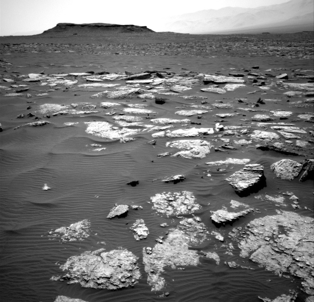 Curiosity really knows how to put you on Mars. This view of exposed bedrock and dark sands was taken by the rover's navigation camera on Friday, Jan. 13. Credit: NASA/JPL-Caltech/MSSS