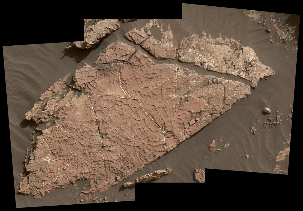 "The network of cracks in this Martian rock slab called ""Old Soaker"" may have formed from the drying of a mud layer more than 3 billion years ago. The view spans about 3 feet (90 centimeters) left-to-right and combines three images taken by the MAHLI camera on the arm of NASA's Curiosity Mars rover. – Image Credits: NASA/JPL-Caltech/MSSS"