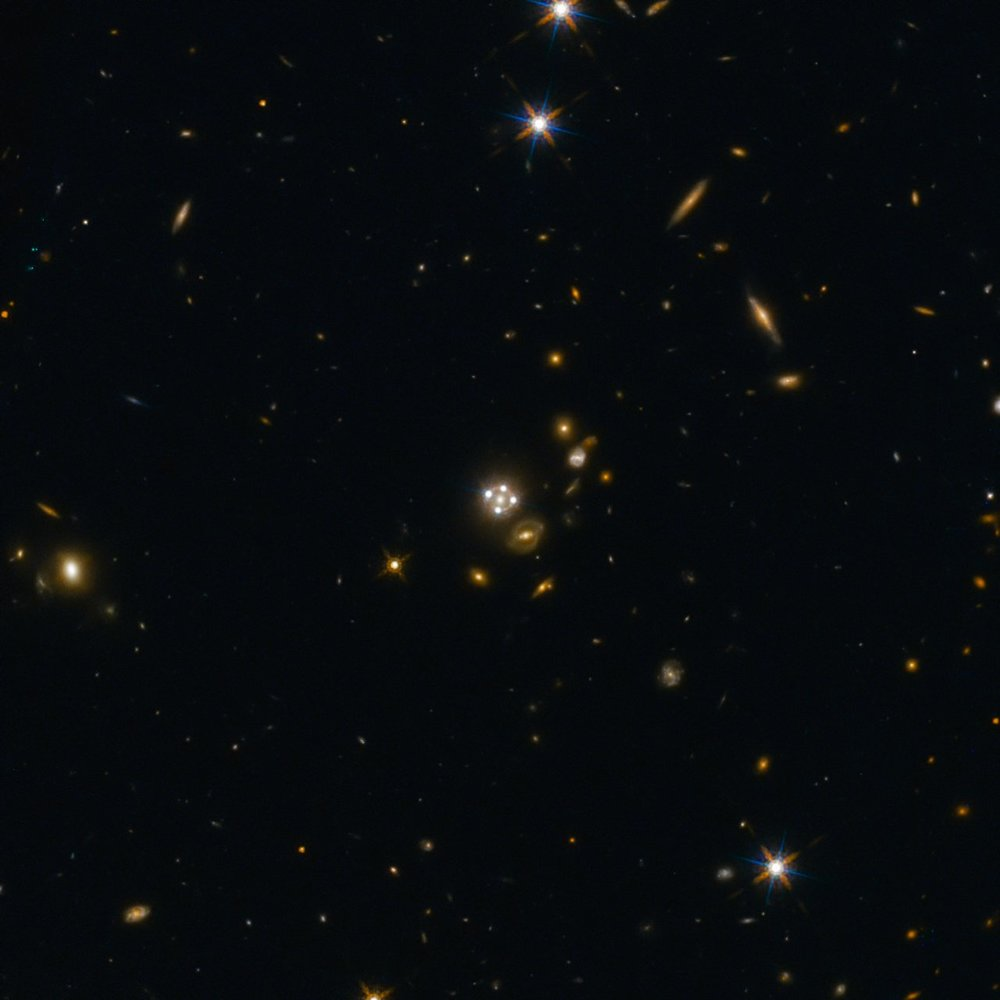 HE0435-1223, located in the centre of this wide-field image, is among the five best lensed quasars discovered to date. The foreground galaxy creates four almost evenly distributed images of the distant quasar around it. – Image Credit: ESA/Hubble, NASA, Suyu et al.