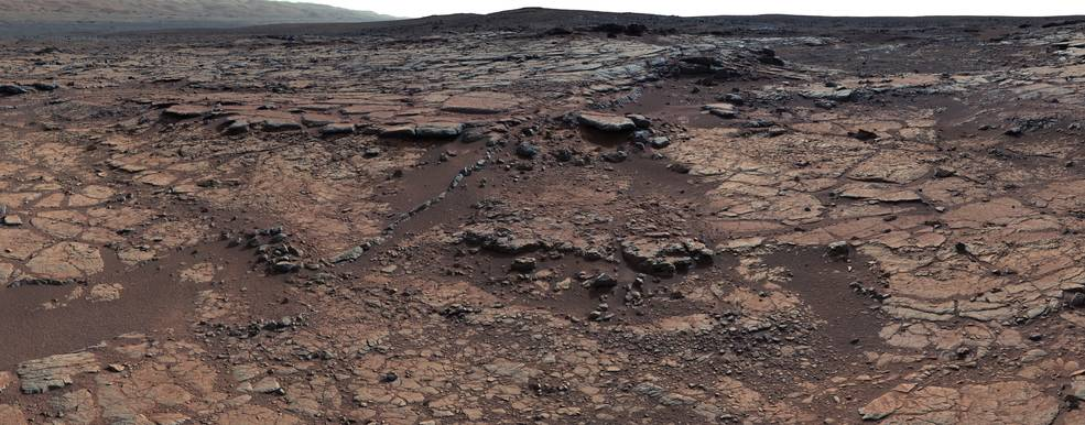 Bedrock at this site added to a puzzle about ancient Mars by indicating that a lake was present, but that little carbon dioxide was in the air to help keep a lake unfrozen. – Image Credits: NASA/JPL-Caltech/MSSS