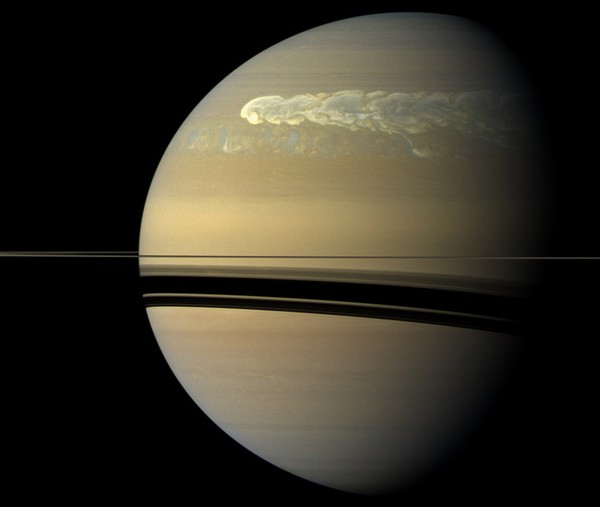 The huge storm churning through the atmosphere in Saturn's northern hemisphere overtakes itself as it encircles the planet in this true-color view from NASA's Cassini spacecraft. - Image Credit: NASA/JPL-Caltech/SSI