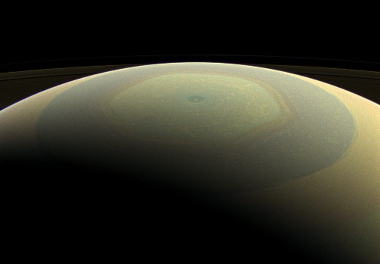 Saturn makes a beautifully striped ornament in this natural-color image, showing its north polar hexagon and central vortex. - Image Credit: NASA/JPL-Caltech/Space Science Institute