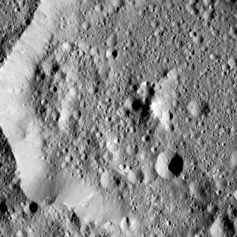 Ernutet crater is featured in this image from Ceres, taken by NASA's Dawn spacecraft. - Image Credit: NASA/JPL-Caltech/UCLA/MPS/DLR/IDA