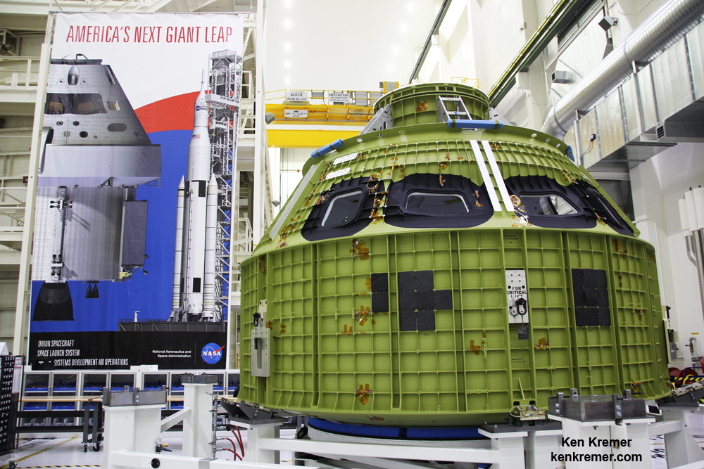 Orion crew module pressure vessel for NASA's Exploration Mission-1 (EM-1) is unveiled for the first time on Feb. 3, 2016 after arrival at the agency's Kennedy Space Center (KSC) in Florida. It is secured for processing in a test stand called the birdcage in the high bay inside the Neil Armstrong Operations and Checkout (O&C) Building at KSC. Launch to the Moon is slated in 2018 atop the SLS rocket. - Image Credit: Ken Kremer/kenkremer.com
