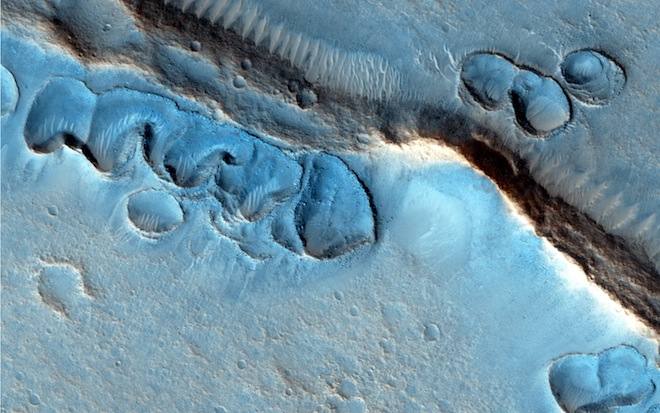 These odd ridges are still a mystery. Were they formed by glaciers? Oceans? -Image: NASA/JPL-Caltech/Univ. of Arizona