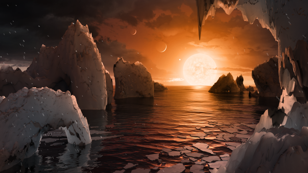 Illustration showing the possible surface of TRAPPIST-1f, one of the newly discovered planets in the TRAPPIST-1 system. - Image Credits: NASA/JPL-Caltech