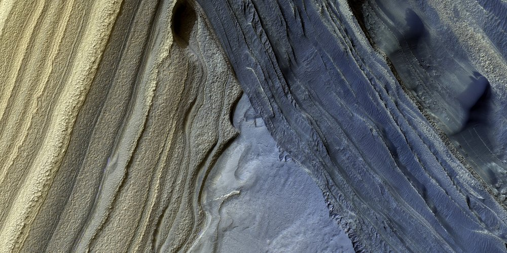 HiRISE image showing the layered appearance of Mars' northern polar region. - Image Credit: NASA/JPL/University of Arizona