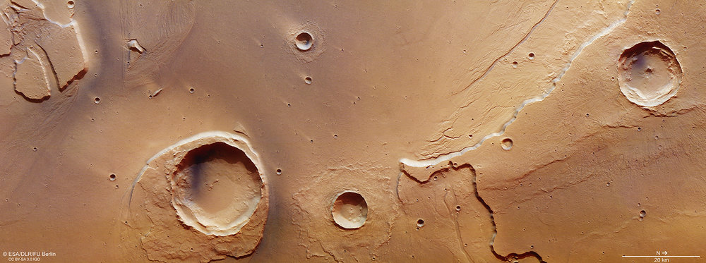Perspective view looking from an unnamed crater towards the Worcester Crater. The region sits at the mouth of Kasei Valles, where fierce floodwaters emptied into Chryse Planitia. Credit: ESA/DLR/FU Berlin