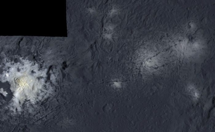 False color mosaic showing parts of Occator crater, with a central pit containing the brightest material on Ceres. It measures 11 kilometers in diameter and in the middle of the pit a dome towers 400 meters high. The dome could be the remnant of a cryovolcano. - Image Credit: NASA/JPL-Caltech/UCLA/MPS/DLR/IDA