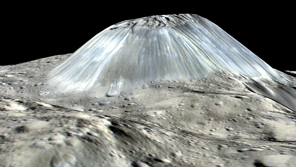 Ceres' lonely mountain, Ahuna Mons, is seen in this simulated perspective view. The elevation has been exaggerated by a factor of two. - Image Credit: NASA/JPL-Caltech/UCLA/MPS/DLR/IDA/PSI