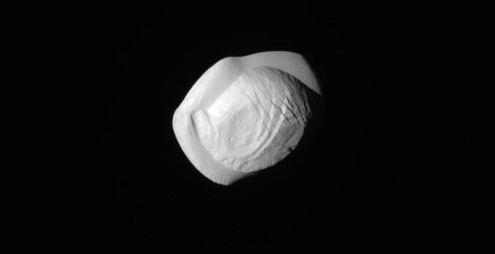 "Saturn's ""UFO moon"" Pan up close. - Image Credit: NASA/JPL/Space Science Institute"