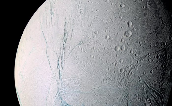 "This enhanced-color Cassini view of southern latitudes on Enceladus features the bluish ""tiger stripe"" fractures that rip across the south polar region. - Image Credits: NASA/JPL-Caltech/Space Science Institute"