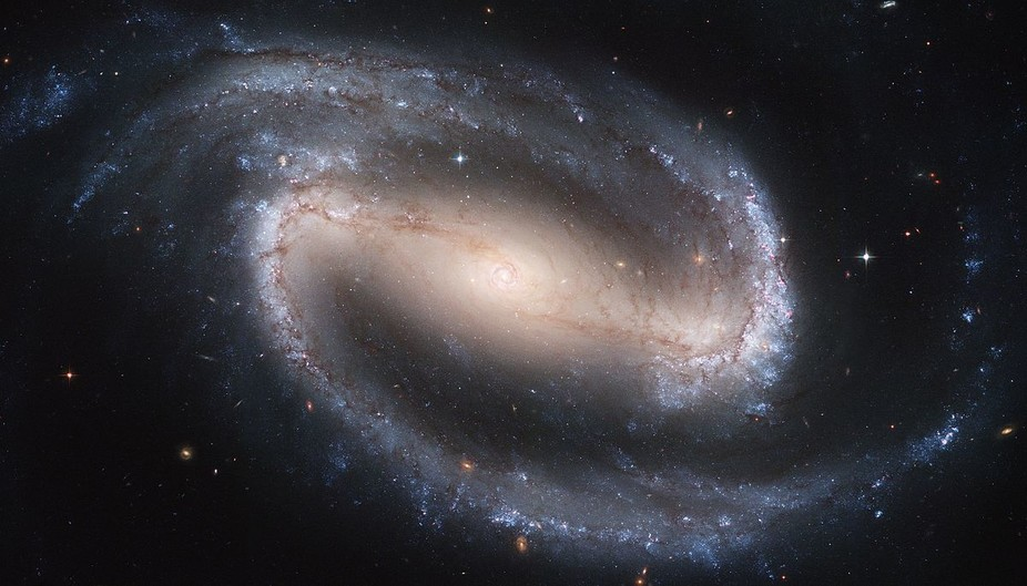 Most modern spiral galaxies, such as NGC 1300, are thought to have loads of dark matter in their outer regions. - Image Credit: NASA, ESA, and The Hubble Heritage Team STScI/AURA)