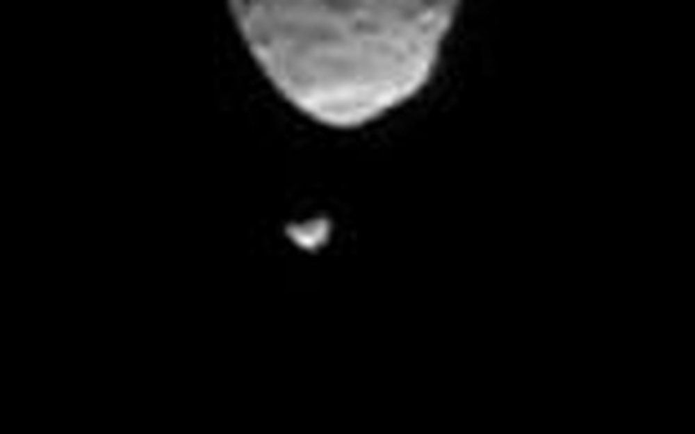 The image from NASA's Curiosity Mars rover shows one of Mars' two moons, Phobos, passing directly in front of the other, Deimos, in 2013. New research suggests the moons consolidated long ago from dust rings around the planet and, in the distant future, may disintegrate into new rings. - Image Credits: NASA/JPL-Caltech/Malin Space Science Systems/Texas A&M Univ.