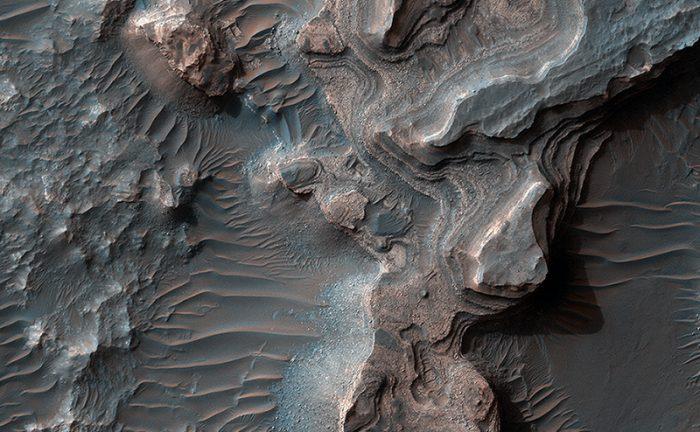 Layered deposits in Uzboi Vallis on Mars, as seen by the HiRISE camera on the Mars Reconnaissance Orbiter. - Image Credit: NASA/JPL/University of Arizona.