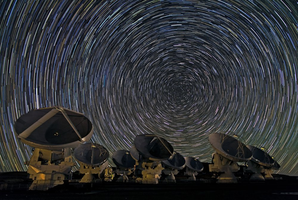 The Atacama Large Millimeter/submillimeter Array is made up of 66 antennas, all pointed at the sky collecting data 24 hours a day. - Image Credit:  ESO/B. Tafreshi (twanight.org)