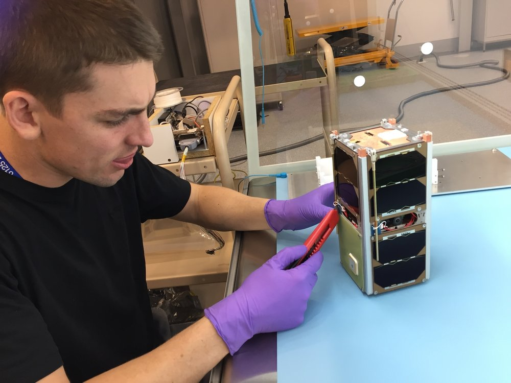PhD student Ben Southwell working on the loaf-sized UNSW-ECO satellite at AITC. UNSW, Author provided