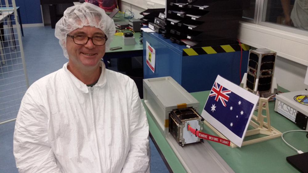 The University of Sydney's Prof Iver Cairns with its i-INSPIRE-2 cubesat. UNSW/University of Sydney, Author provided