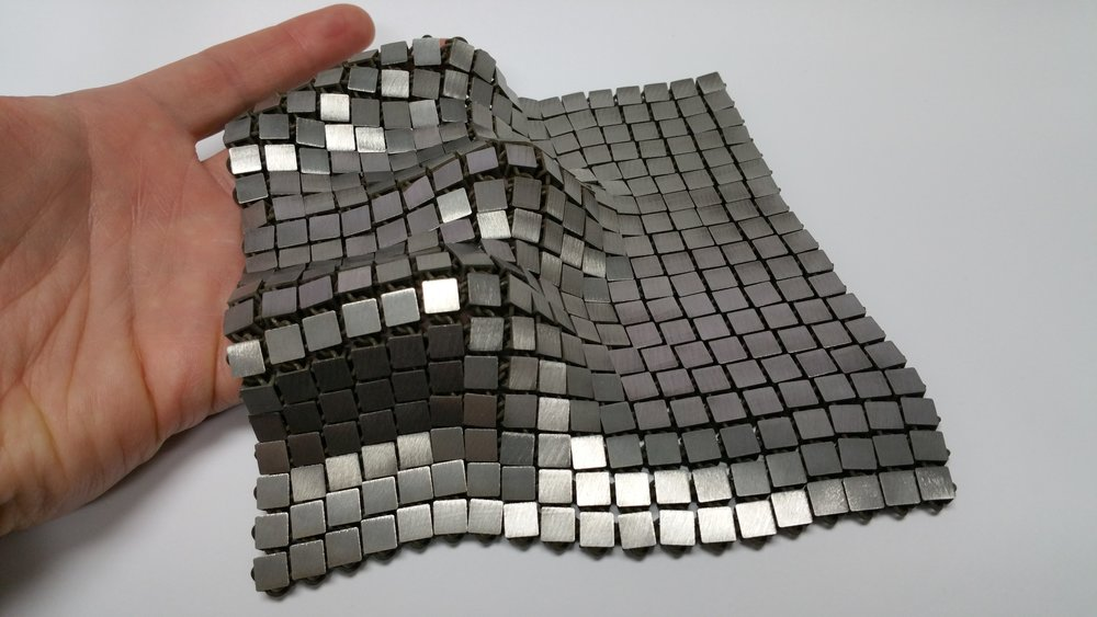 "This metallic ""space fabric"" was created using 3-D printed techniques that add different functionality to each side of the material. - Image Credits: NASA/JPL-Caltech (click to enlarge)"