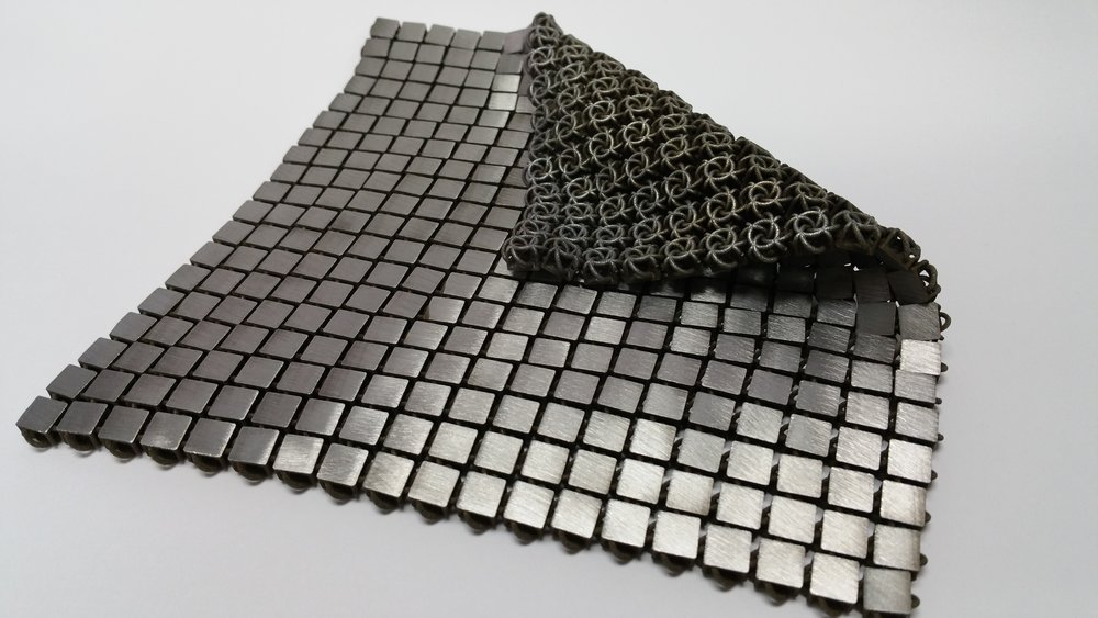 "Another example of a 3-D-printed metallic ""space fabric."" The bottom and top sides of the fabric are designed to have different functionality. - Credits: NASA/JPL-Caltech (click to enlarge)"