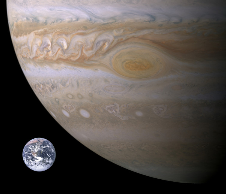 The Solar system's largest planet, Jupiter, dwarfs the Earth, with this composite picture showing the two side-by-side for comparison. - Image Credit: NASA