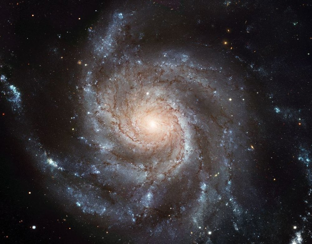 The Pinwheel Galaxy (M101, NGC 5457) is a stunning example of a spiral galaxy. This study determines that there likely is no evolutionary link between sub-millimeter galaxies and spiral galaxies. - Image: European Space Agency & NASA