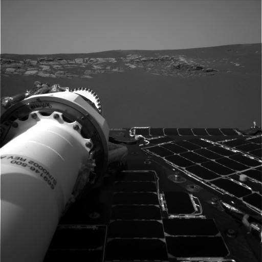 Opportunity's navigation camera took this picture, one of the rover's first, of the inside of Eagle Crater. Exposed Martian rocks are visible. - Image Credit: NASA/JPL