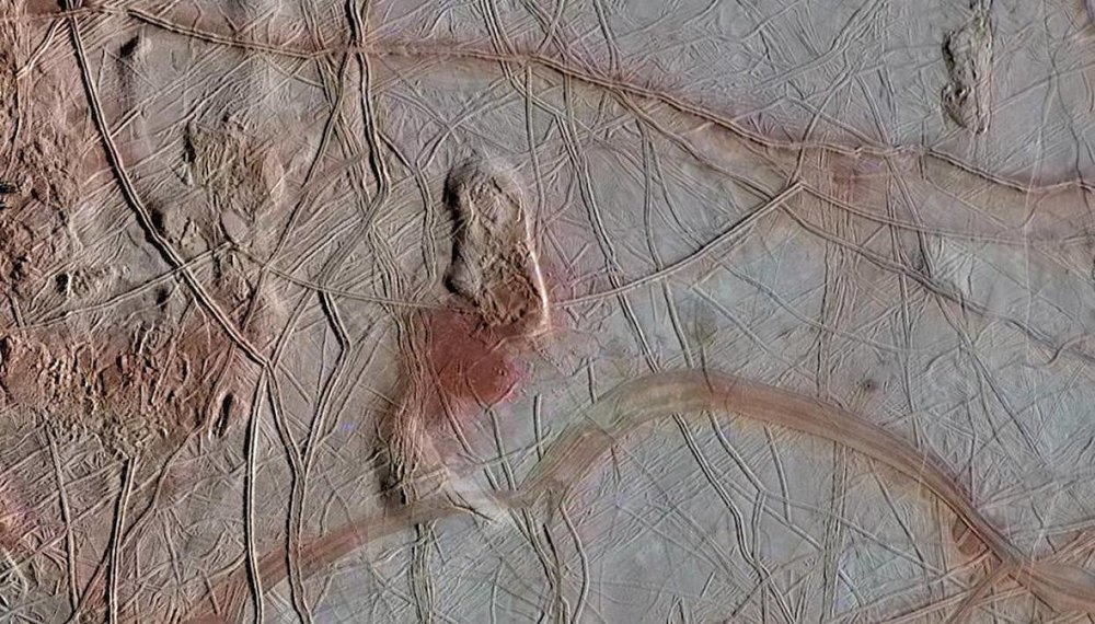 "Image of Europa's ice shell, taken by the Galileo spacecraft, of fractured ""chaos terrain"". - Image Credit: NASA/JPL-Caltech"