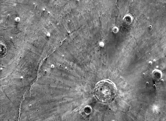 An infrared image revealing strange bright streaks extending from Santa Fe crater on Mars. - Image Credit: NASA/JPL-Caltech/Arizona State University.
