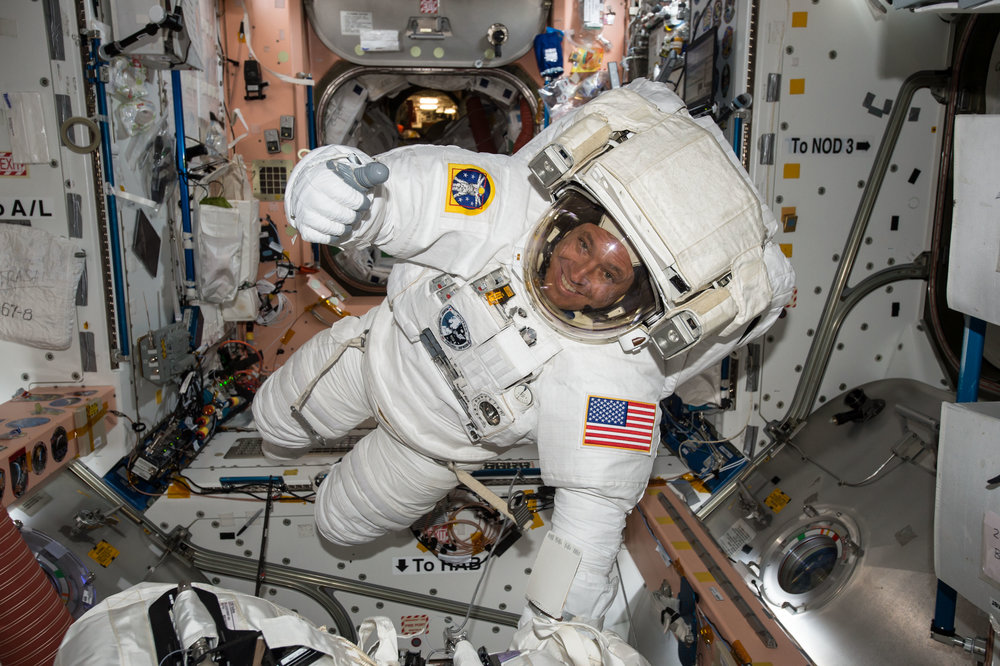 NASA astronaut Jack Fischer checks out his spacesuit while preparing for a spacewalk outside the International Space Station. - Image Credits: NASA