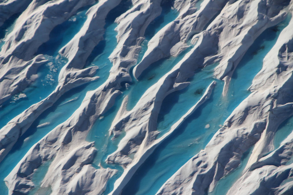 Meltwater in crevasses in southern Greenland, as seen during Operation IceBridge's last flight of the 2017 Arctic campaign, on May 11, 2017. - Image Credit: NASA/John Sonntag (Click to enlarge)
