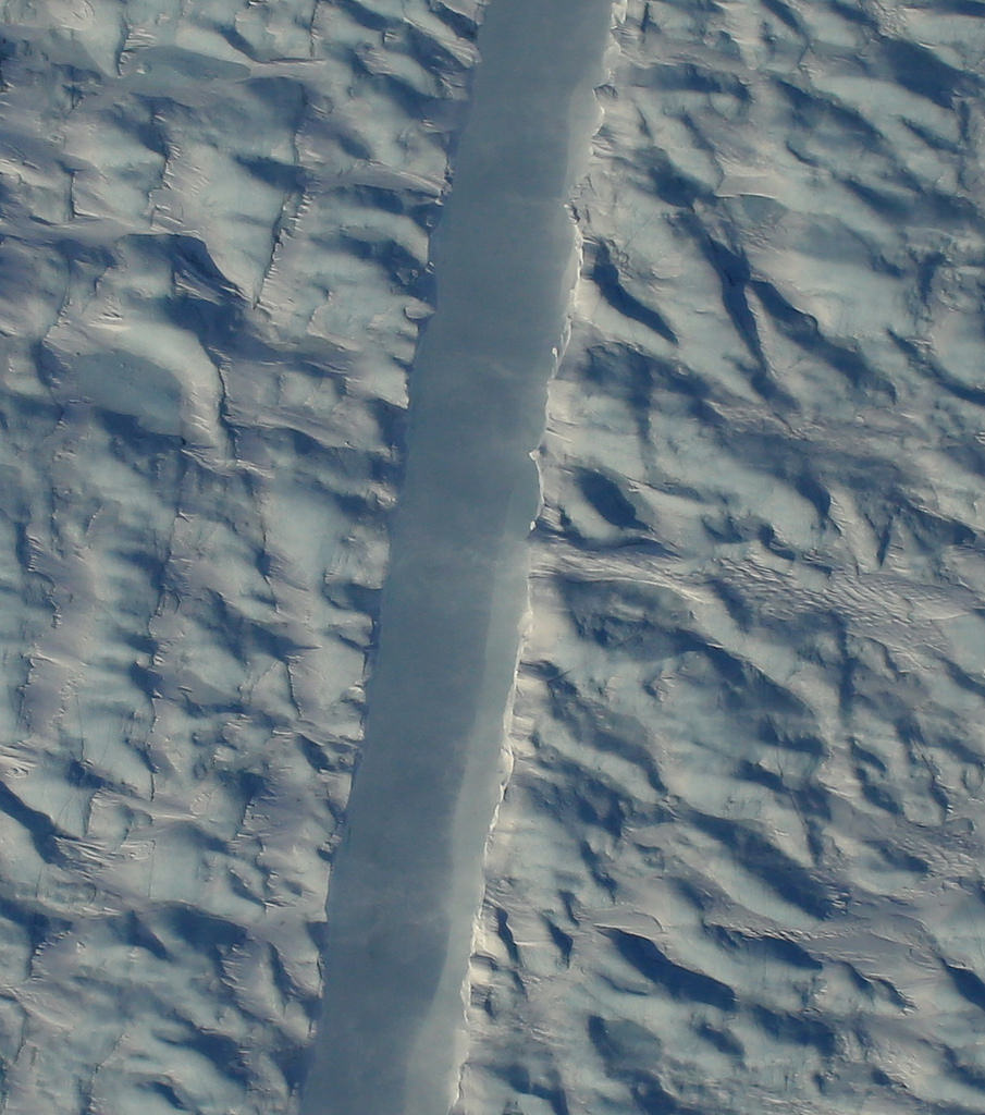 Operation IceBridge flew over a new crack in Petermann Glacier, one of the largest and fastest-changing glaciers in Greenland, on April 14, 2017, just a few days after the rift was detected in satellite imagery. - Image Credits: NASA/Gary Hoffmann