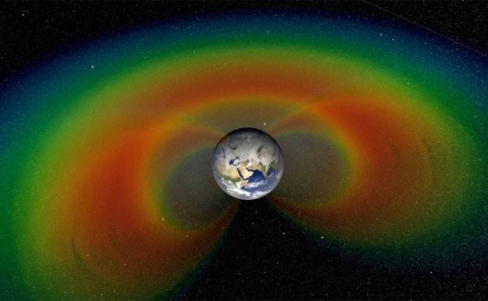 -     Artist's depiction with cutaway section of the two giant donuts of radiation, called the Van Allen Belts, that surround Earth. -Image Credit: NASA