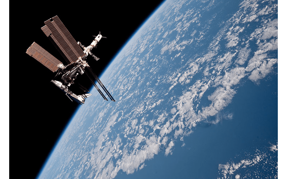 The AMS being delivered to the ISS by the Space Shuttle Endeavour in 2011. - Image Credit: NASA