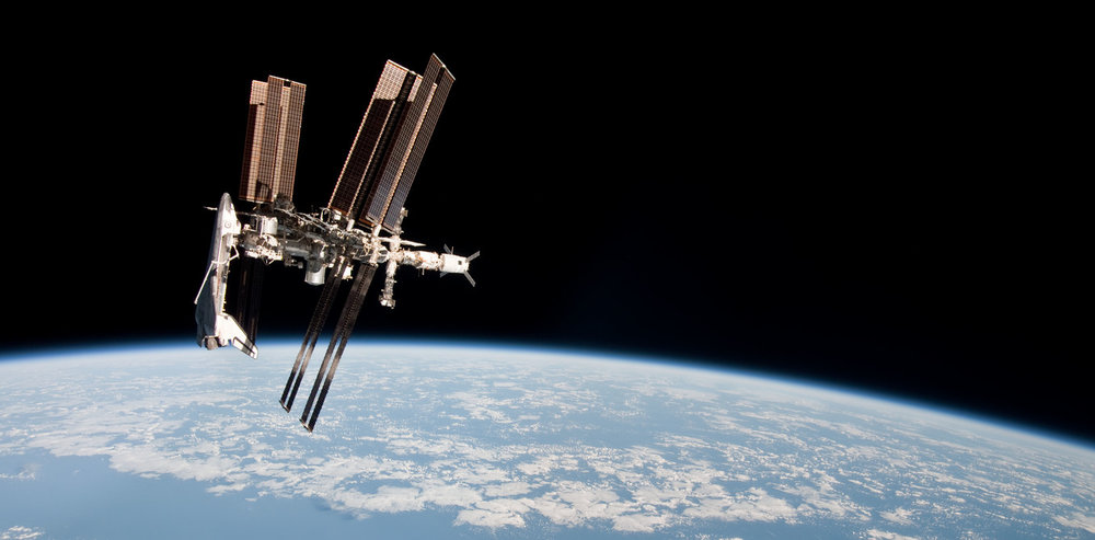 ISS and Endeavour seen from the Soyuz TMA spacecraft. - Image Credit: NASA