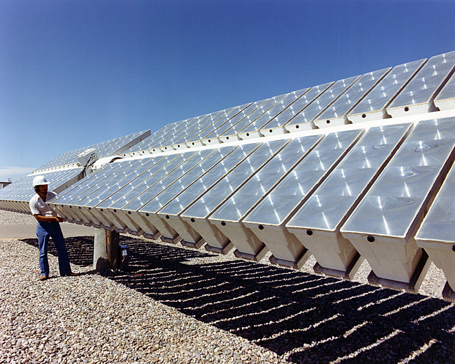 Checking the power output of a photovoltaic concentrator array built by Martin Marietta, Inc., at Sandia National Laboratory in Albuquerque, New Mexico. - Image Credit:  USDOE/Flickr