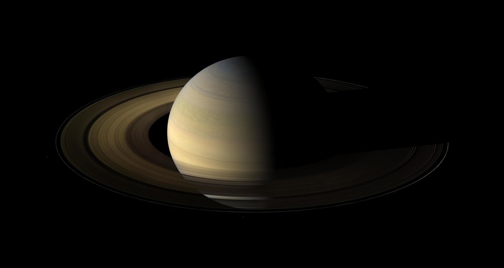 Cassini's view of Saturn during its 2009 equinox shows both the northern and southern hemispheres equally sunlit, with the north pole half in shadow. Since then, the sun has risen fully over the north, while the south has slipped into winter shadow. - Image Credits: NASA/JPL/Space Science Institute
