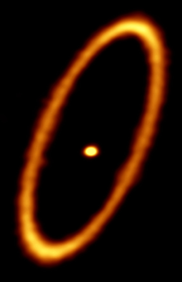 ALMA image of the debris disk in the Fomalhaut star system. The ring is approximately 20 billion kilometers from the central star and about 2 billion kilometers wide. The central dot is the unresolved emission from the star, which is about twice the mass of our sun. - Image Credit: ALMA (ESO/NAOJ/NRAO); M. MacGregor (click to enlarge)