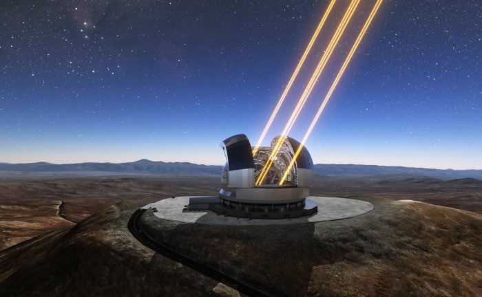 This artist's rendering shows the Extremely Large Telescope in operation on Cerro Armazones in northern Chile. The telescope is shown using lasers to create artificial stars high in the atmosphere. - Image Credit: ESO/E-ELT