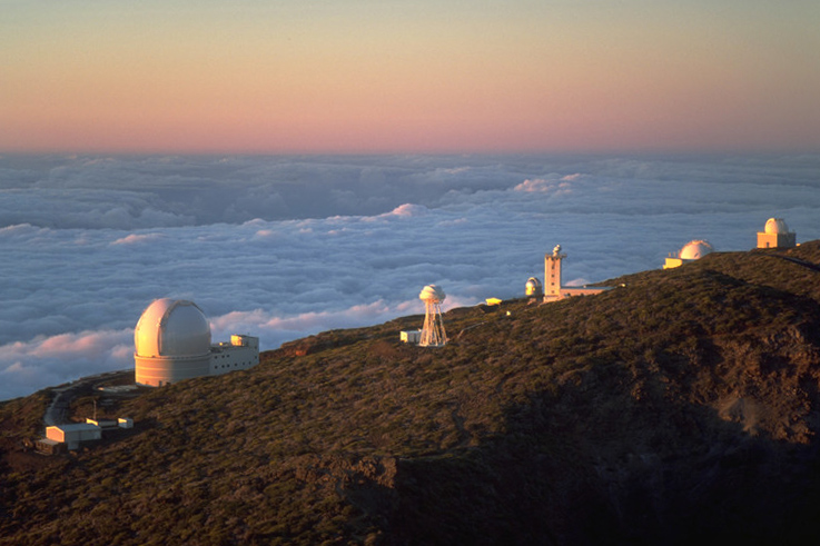 Part of Roque de los Muchachos Observatory, including the Isaac Newton Group of Telescopes. The William Herschel Telescope is the large dome on the left, the Isaac Newton Telescopeis located second from the right, and the Jacobus Kapteyn Telescopeis located on the far right. - Image Credit: Bob Tubbs/WikimediaCommons