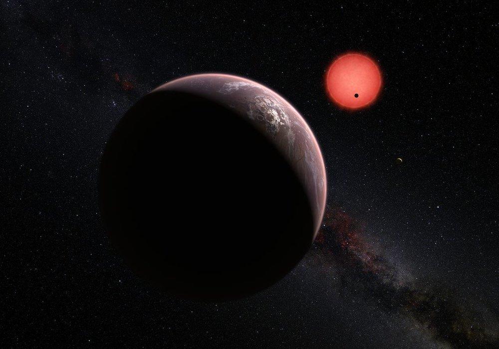 Artist's impression of of the exoplanets orbiting a red dwarf star. - Image Credit: ESO/M. Kornmesser/N. Risinger (skysurvey.org).