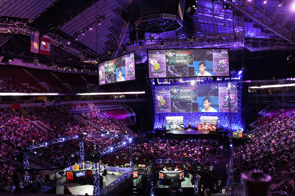 Picture of a crowded KeyArena during The International, an annual Dota 2 tournament - Image Credit:  Jakob Wells