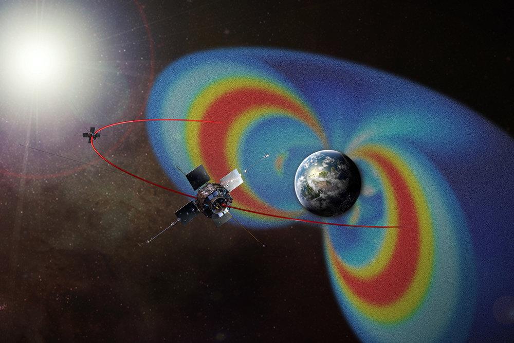 Artist's depiction of NASA's Van Allen Probes, with the Van Allen radiation belts rendered in false color for visibility - Image Credit:NASA