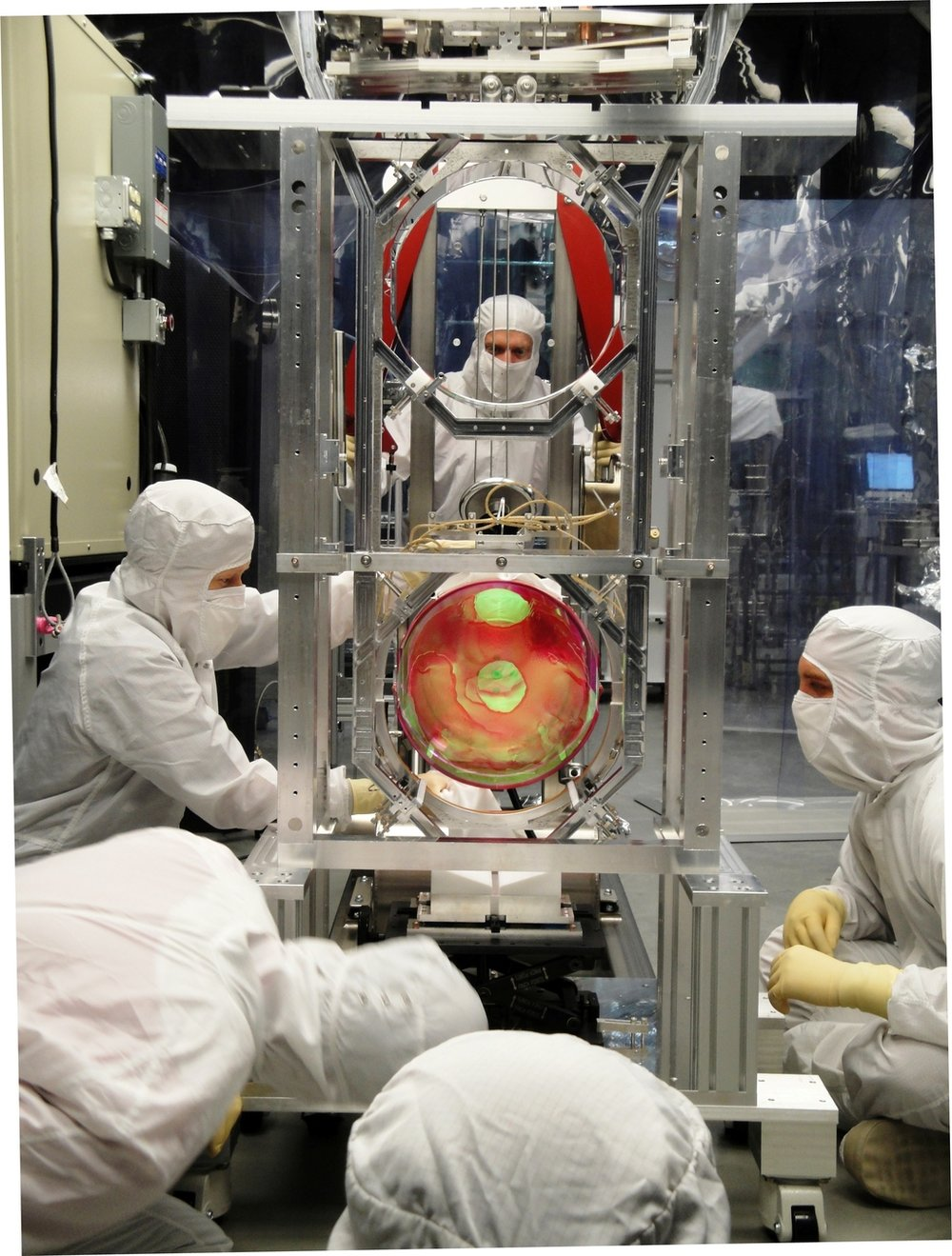 LIGO scientists working on its optics suspension. - Image Credit: LIGO Laboratory, CC BY-ND