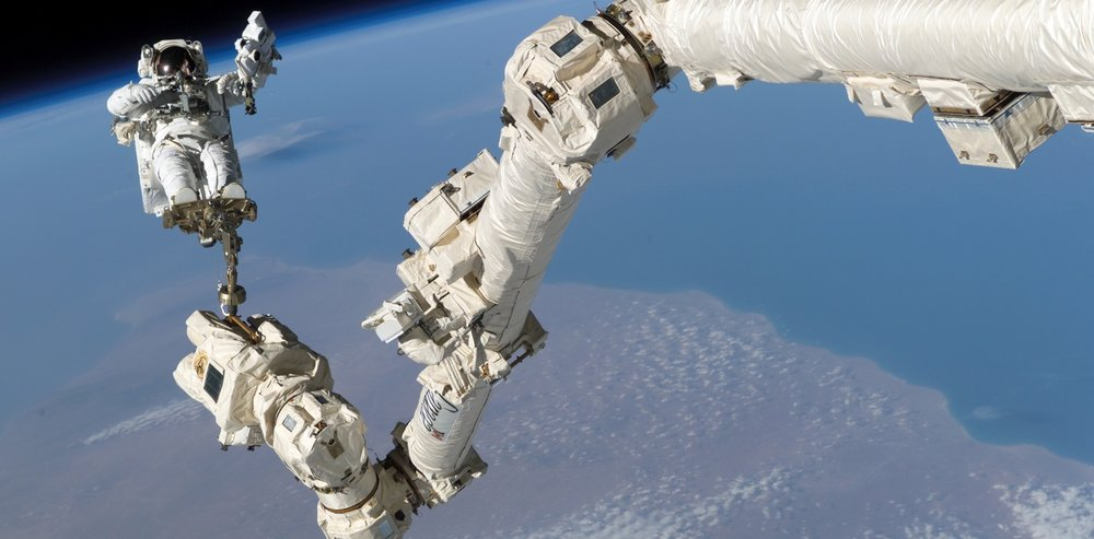 STS Steve Robinson on Canadarm - Image Credit:  NASA
