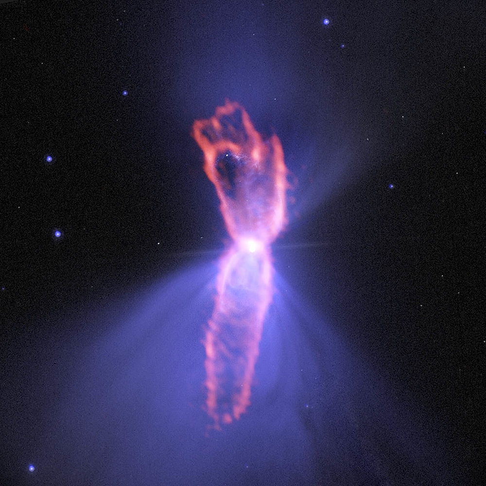 Composite image of the Boomerang Nebula, with ALMA observations (orange) showing the e hourglass-shaped outflow on top of an image from the Hubble Space Telescope (blue). - Image Credit: ALMA (ESO/NAOJ/NRAO); NASA/ESA Hubble; NRAO/AUI/NSF