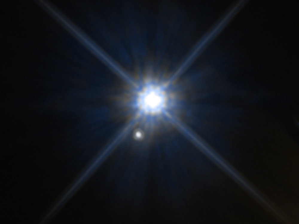 Hubble image showing the white dwarf star Stein 2051B and the smaller star below it appear to be close neighbors. - Image Credit: NASA/ESA/K. Sahu (STScI)