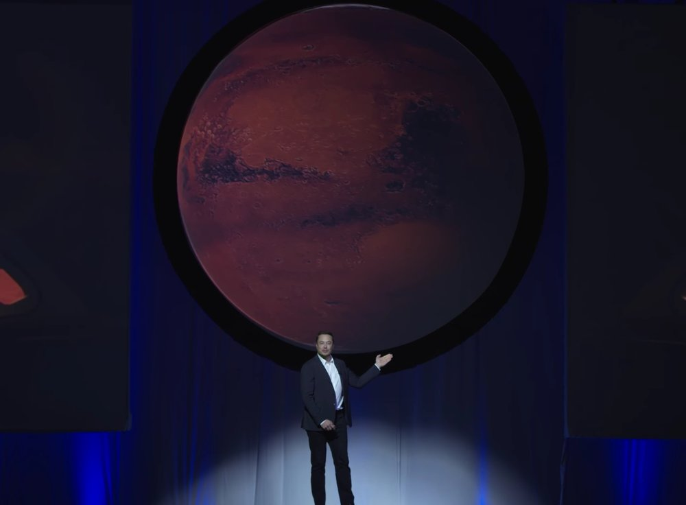 Elon Musk revealing his Mars Plans at the 67th annual meetings of the IAC. - Image Credit: SpaceX/IAC