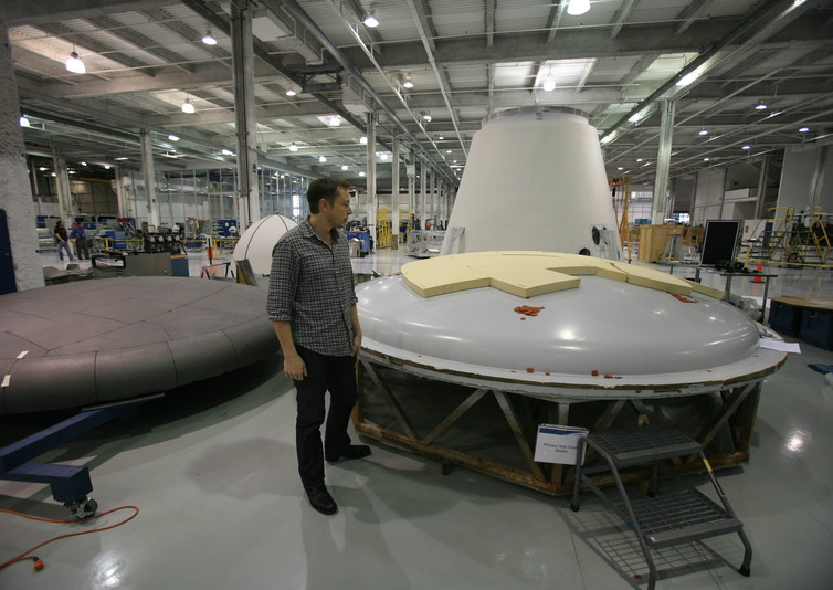 Musk inspecting a heat shield at the SpaceX factory. - Image Credit: Steve Jurvetson/Flickr,CC BY
