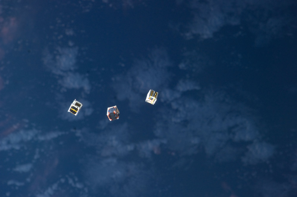 Cubesats being launched from the International Space Station. - Image Credit: NASA